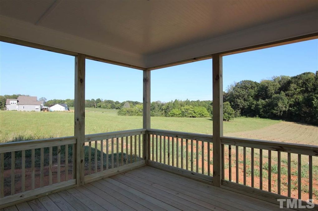 Screen Porch in new farmhouse on acreage by Chatham County custom home builder Travars Built Homes