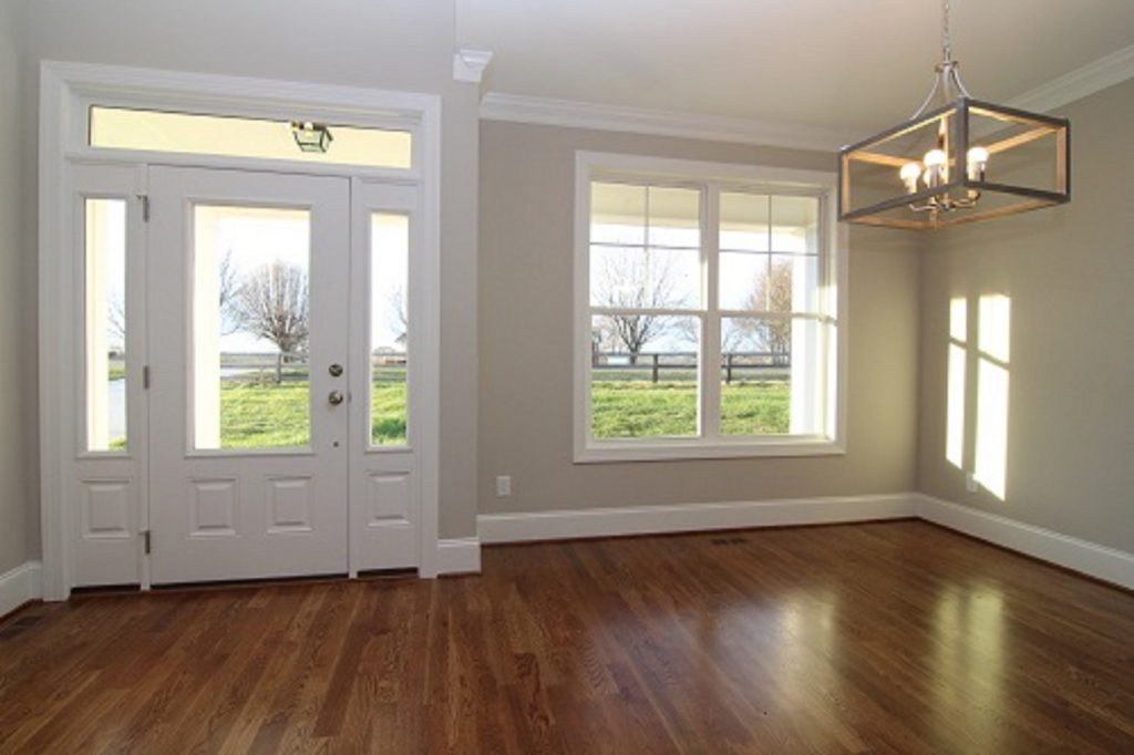 3/4 Glass Front Entry Door with Sidelights and Transom, Minwax Provincial Floor Stain, SW-7043 Worldly Grey paint color.  Custom Home Builders Travars Built Homes Raleigh NC