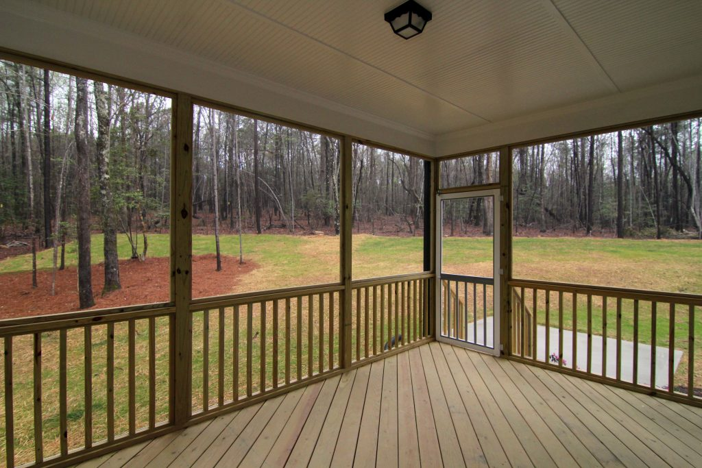 Screen porch with diagonal lay decking and beadboard ceiling, Chatham County NC home builders