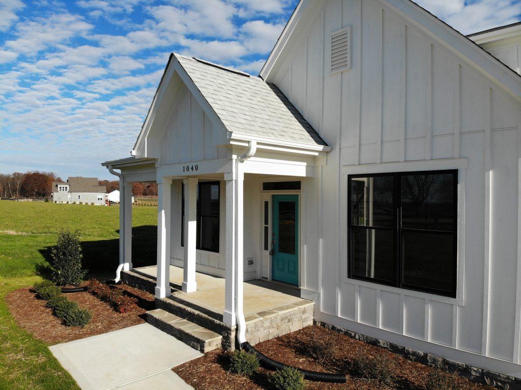Modern Farmhouse with White Board and Batt siding.