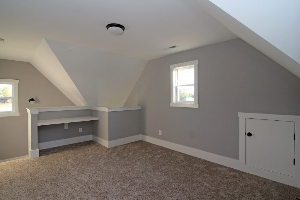 Built in desk in alcove, in finished third floor.  Dog ear craftsman trim, Talk of the Town Oyster Bay carpet, Sherwin Williams 6002 Essential Gray wall color, SW 7004 Snowbound trim color