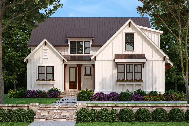 New modern farmhouse in historic downtown Pittsboro.  White board/batt exterior with dark windows and metal roof accents.